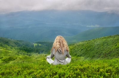 meditating in mountain with perfect affirmation